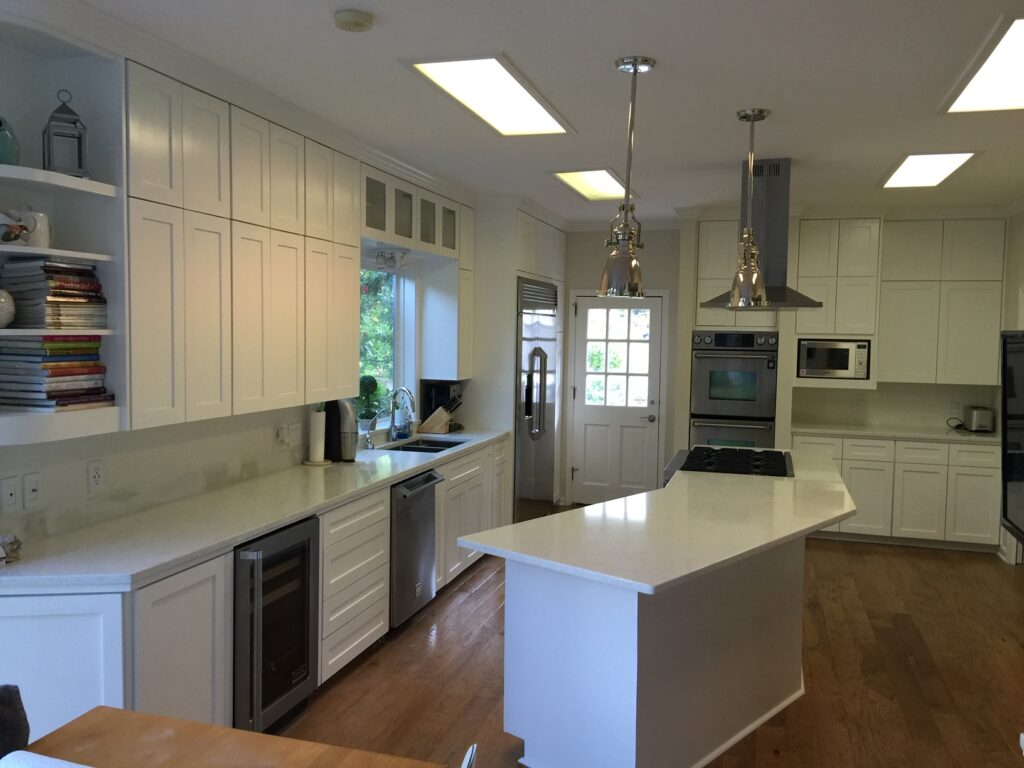 Beautiful White kitchen with island and white top