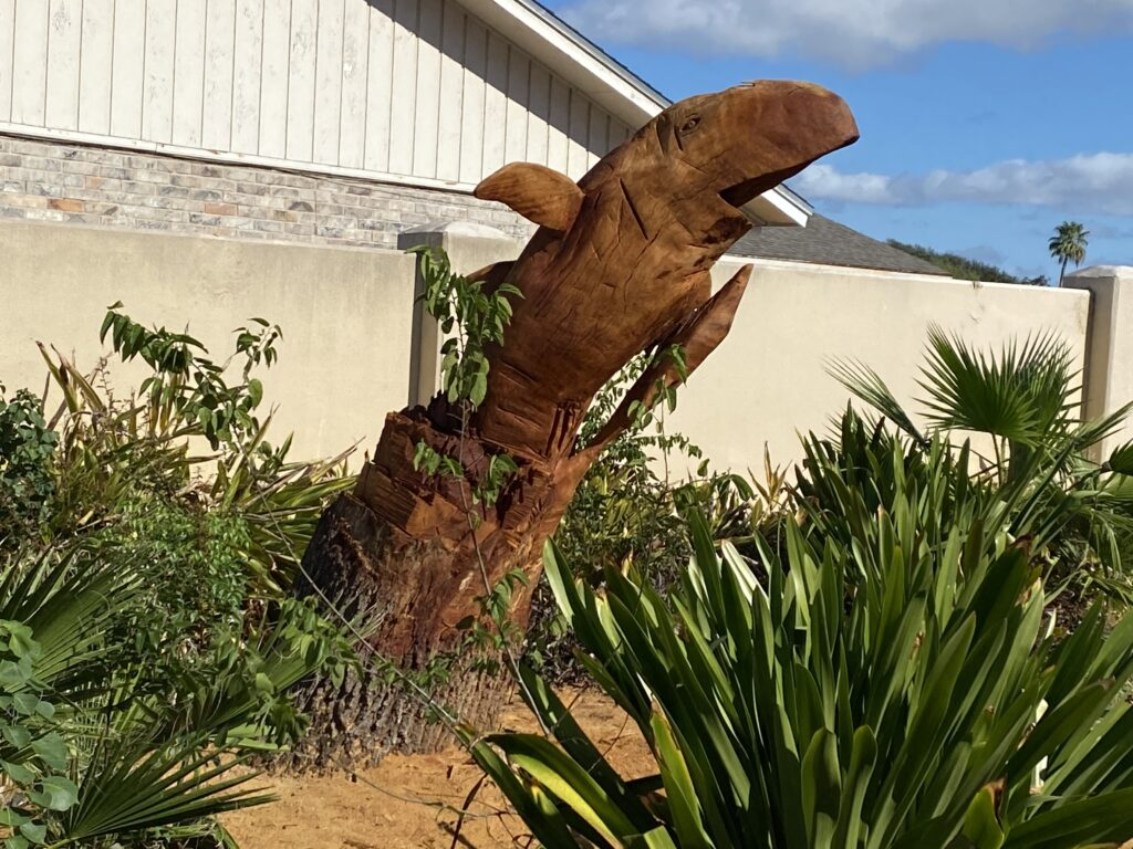Whale carving in a garden in texas